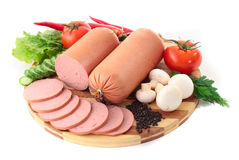 Sausage on plate with vegetables. Isolated on white background Royalty Free Stock Photos