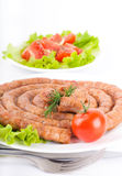 Sausage from pork and beef with tomatoes and spice Royalty Free Stock Photo
