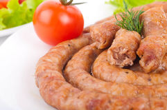 Sausage from pork and beef with  vegetable salad Royalty Free Stock Photo