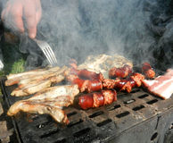 Sausage, pork meat and ham  on a  grill Stock Photography