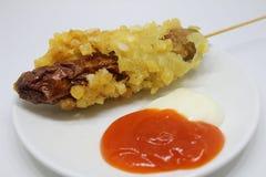 Sausage potato sate sauce mayonaise street food Stock Photos