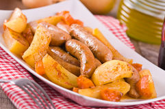 Sausage and potatoes. Royalty Free Stock Image