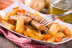 Sausage and potatoes. Stock Photo