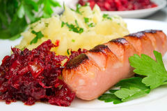 Sausage with potatoes. Beet and parsley Stock Images