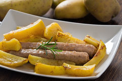 Sausage and potatoes. Stock Images