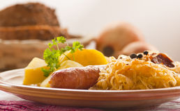 Sausage with potatoes and sauerkraut Royalty Free Stock Photos