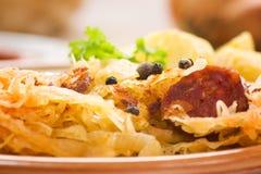Sausage with potatoes and sauerkraut Stock Photos