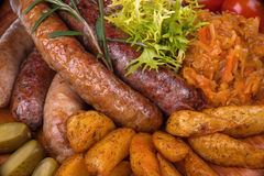 Sausage and potatos Stock Photo