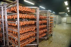 Meat sausage processing in factory. Sausage processing in factory warehouse for storing meat products stock photos