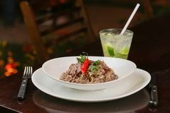 Sausage risotto with alcohol caipirinha royalty free stock image