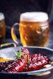 Sausage. Roasted chorizo sausage. Roasted spicy sausage chorizo home hotel or restaurant with beer vine brandy cognac whiskey. Royalty Free Stock Photos