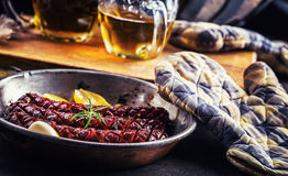 Sausage. Roasted chorizo sausage. Roasted spicy sausage chorizo home hotel or restaurant with beer vine brandy cognac whiskey. Royalty Free Stock Photography