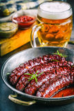 Sausage. Roasted chorizo sausage. Roasted spicy sausage chorizo home hotel or restaurant with beer vine brandy cognac whiskey. Stock Images