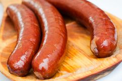 Sausage roasted on the grill Royalty Free Stock Images