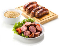 Sausage roasted on the grill. royalty free stock images