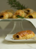 Sausage roll. Breadbaked sausage snack party roll Royalty Free Stock Photos