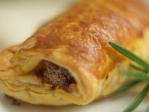 Sausage roll. Breadbaked sausage snack party roll Royalty Free Stock Images