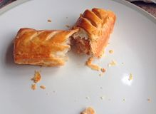 Sausage roll broken in half. Stock Images