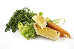 Sausage Roll with Carrots and Celery Stock Photos