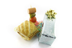 Sausage Roll with Gift and Cocktail Stick Royalty Free Stock Photos
