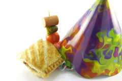 Sausage Roll and Party Hat Royalty Free Stock Photos