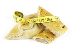 Sausage Roll with Pasty and Tape Measure Stock Photography