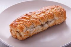 Sausage Roll on plate Royalty Free Stock Images