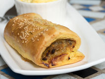Sausage roll in white plate Stock Images