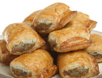 Sausage Rolls. Freshly baked sausage rolls piled on a plate Royalty Free Stock Photo