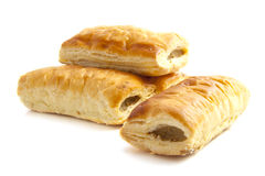 Sausage rolls. Four sausage rolls isolated on a white background royalty free stock image