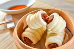 Sausage rolls in bamboo tray in asian restaurant Royalty Free Stock Image