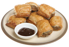 Sausage Rolls & Brown Sauce. Sausage rolls with brown sauce dip Royalty Free Stock Images