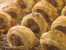 Sausage Rolls on a Cooling Rack. Close Up of Sausage Rolls on a Cooling Rack stock photos