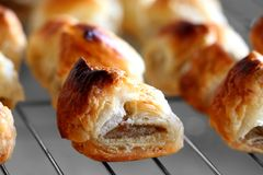 Sausage rolls on a cooling rack Stock Image