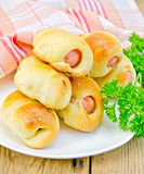 Sausage rolls with parsley on the board Royalty Free Stock Images