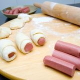 sausage rolls prepared with freshly made dough. Royalty Free Stock Photography
