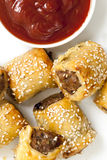 Sausage Rolls. With tomato sauce or ketchup.  Overhead view Royalty Free Stock Photos
