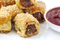 Sausage Rolls. With tomato sauce or ketchup.  Puff pastry sprinkled with sesame seeds Stock Photography