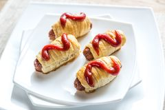 Sausage rolls with tomato sauce Royalty Free Stock Image