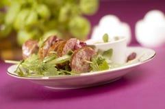 Sausage with salad Stock Photos