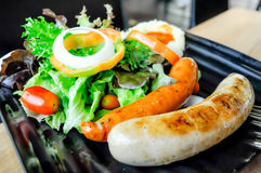 Sausage and salad. Dish on the table Royalty Free Stock Image