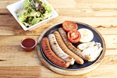 Sausage, salad sesame sauce Royalty Free Stock Image