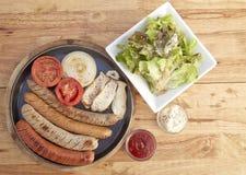 Sausage, salad sesame sauce Royalty Free Stock Photos