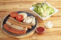 Sausage, salad sesame sauce Stock Photography