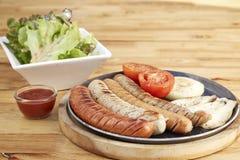 Sausage, salad sesame sauce Stock Image