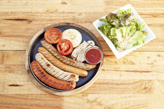 Sausage, salad sesame sauce Royalty Free Stock Photo