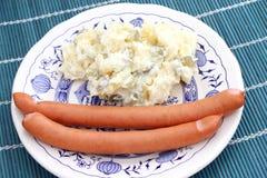 Sausage and salad. Some fresh sausage with a salad of potatoes Stock Photos