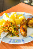 Sausage, salads and potato. Royalty Free Stock Photos