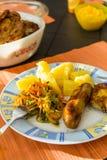 Sausage, salads and potato. Royalty Free Stock Images