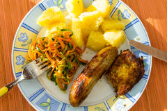 Sausage, salads and potato . Stock Images
